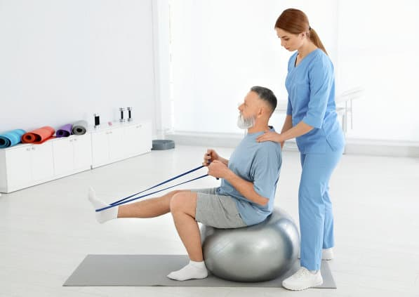 man having an excercise using a ball